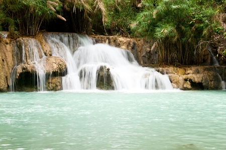 Waterfall and blue stream in the forest Laos Stock Photo