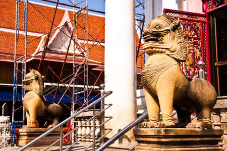 The lion statues made ​​of stone  Stand in front of a temple in Thailand at Phetchaburi province  photo