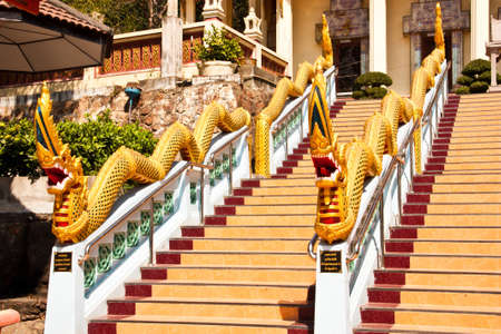 snakes and ladders: The Serpent statue on the ladder at the entrance to Thai temple  Stock Photo