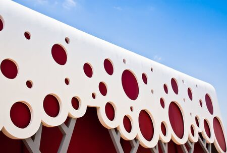 Building walls are made of wood  Design patterns are red and white