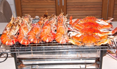 Crab and shrimp are being burned on the grill  photo