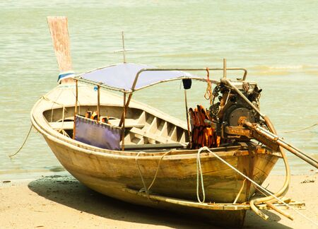 Local fishing boats  Moored in the harbor where the water is not deep  photo