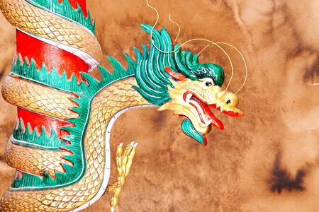The Dragon status isolated on brown is old background