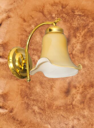 Wall lamps isolated on old wall paper background  photo