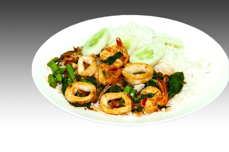 combines: Have a chilli that combines squid and shrimp into the rice  Stock Photo