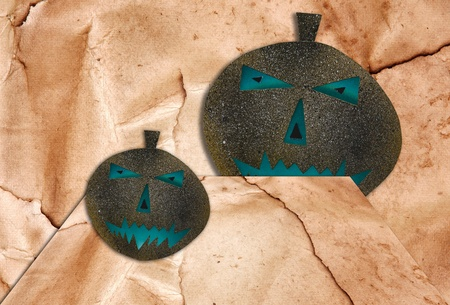 Two Halloween Pumpkins isolated on  brown walls background.