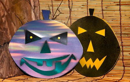 Two Halloween Pumpkins isolated on  brown walls background  Stock Photo
