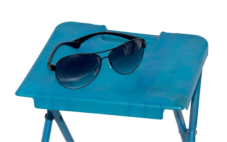 Sunglasses on the table isolated on white background  photo