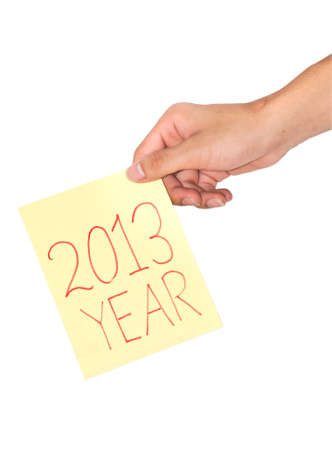 Hand holding a paper notebook wrote that in 2013 photo