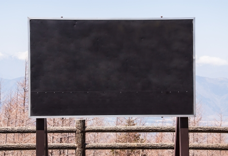 Black wooden  sign empty is mounted on the fence  Stock Photo