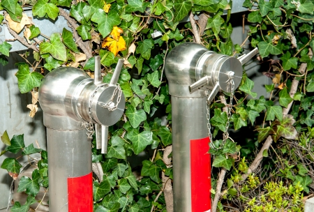stoppage: Fire hose nozzle in the garden. Stock Photo