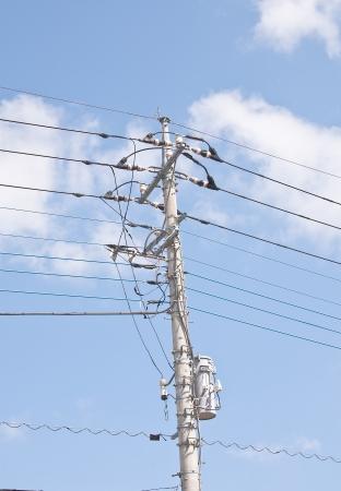 High voltage power pylons sky background