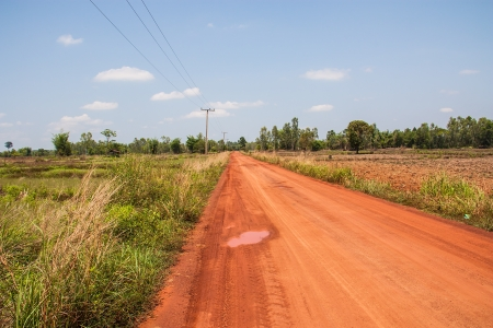 Red Road in the countryside in Thailand Stock Photo
