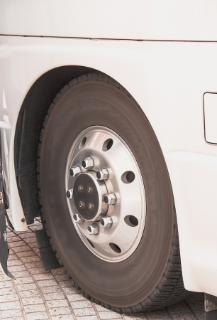 Front wheels of the bus In the side view.