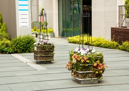 front stoop: Flowers Basket on  the street and near with building