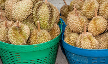 pile of durian In the basket for sale in local market in thailand photo