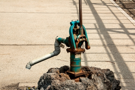 unavailable: Water pump by hand in the old state and unavailable. Stock Photo
