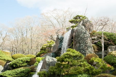 Rocks and waterfall in the garden in japan photo