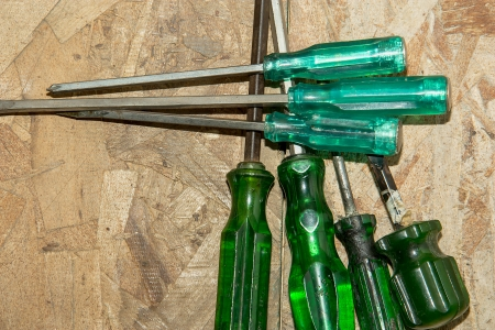 Group of screwdrivers on wood wall background