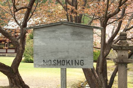 Wooden sign symbol no smoking in the garden  photo