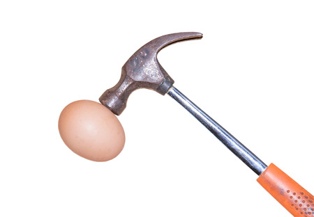 Hammer hit to the eggs isolated on white background Stock Photo