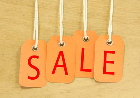 Sale Price tag hanging  with on wooden  Stock Photo