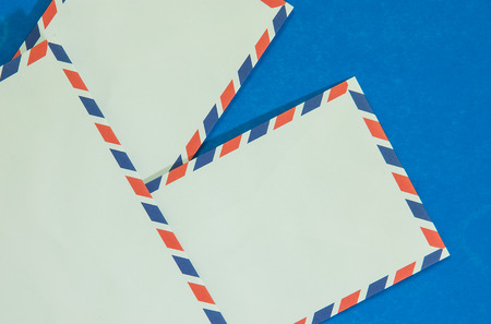Three Air mail envelope interpolate on blue background.