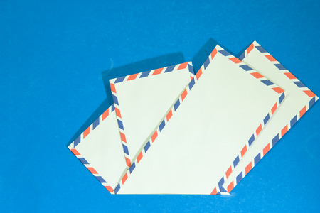 Four Air mail envelope interpolate on blue background.