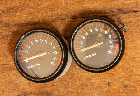 miles: Miles Tachometer on wooden background