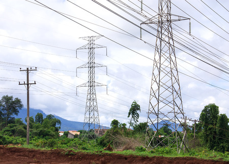 High voltage power pylons were installed through the village. Stock Photo