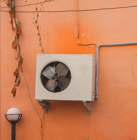 Air conditioners condenser units outdoor on wall