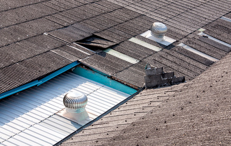 Metal ventilator on the roof of home Stock Photo