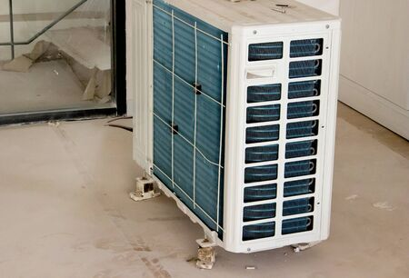 Residential air conditioner condenser unit inside a house Stock Photo