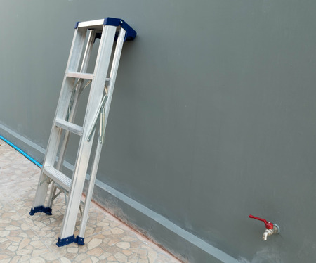 ladder safety: Ladder leaning against the house Stock Photo