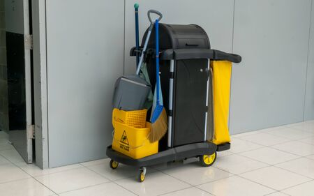 closeup of janitorial. yellow mop bucket and set of cleaning equipment at the airport. 写真素材