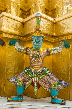 Mythological figure of the indian epic ramayana, the demon guardian, guarding the buddhist temple in the grand palace, Bangkok photo
