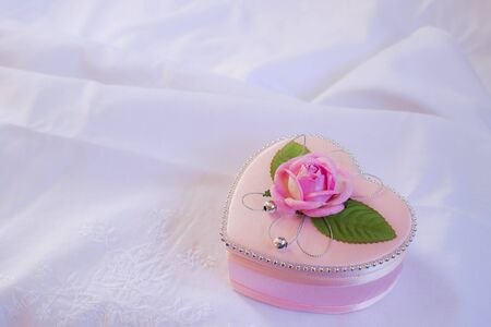 Wedding heart-shaped box with rose petals photo