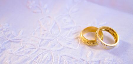 Wedding detail with beautiful golden rings photo