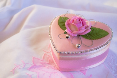 Wedding heart-shaped box with rose petals