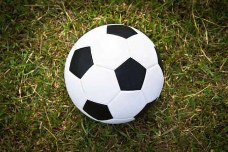 Soccer ball in the goal scoring photo