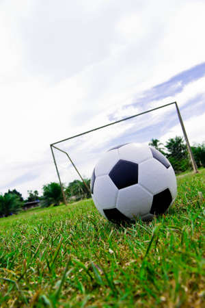 camping pitch: Soccer ball on the green field