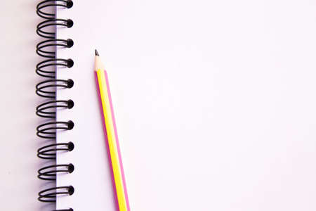 white sketch book and pencil isolated on white