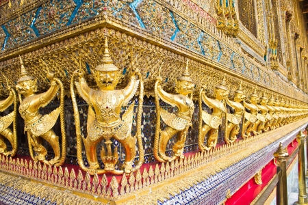 Thailand. The Grand Palace. Temple of the Emerald Buddha. Gold ornamental pattern statuettes.