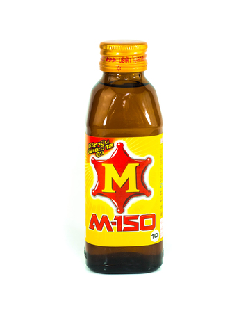 marketed: SURATTHANI, THAILAND APRIL 26, 2016.Glass Bottle of M-150 energy drink isolated on a white background.  M-150 energy drink is a popular product in Thailand.It is marketed by the Thai company Osotspa Co. Ltd Bangkok, Thailand.