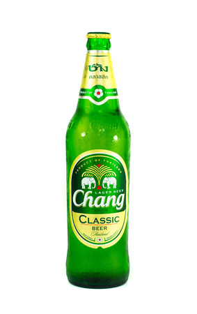 public company: SURATTHANI, THAILAND APRIL 26, 2016.Chang lager beer isolated on white background. Chang beer has been produced by  Thai Beverage Public Company Limited Editorial