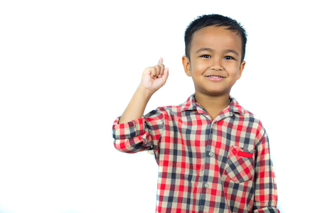 Asian kid pointing up .Young boy have a good idea.