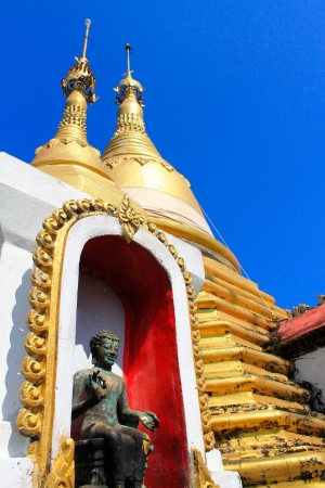 copper statue of a Buddha in Thailand  photo