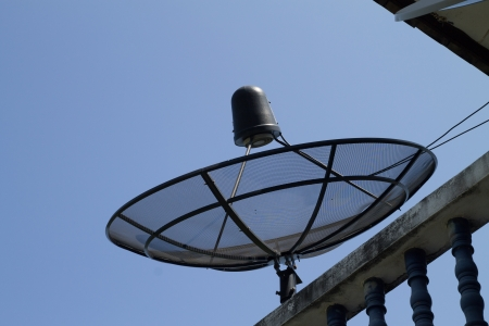 the satelite dish of cable tv for home use on the roof of building Stock Photo - 16465512