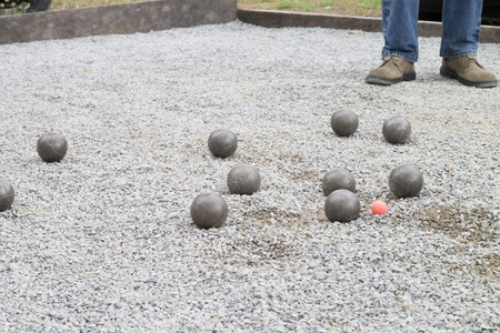 Playing Petanque with cochonnet orange color photo