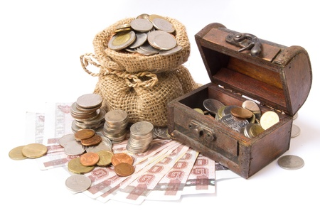 money coins in bag and wooden chest isolated on white